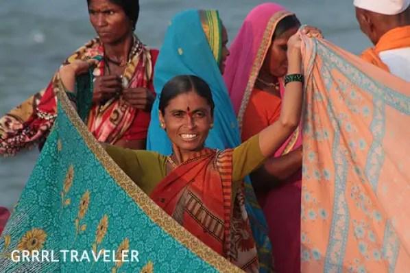 woman drying saris