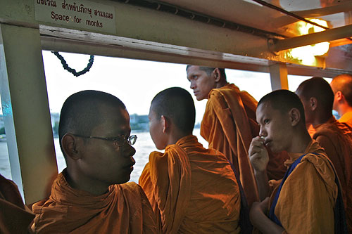 monks on a boat