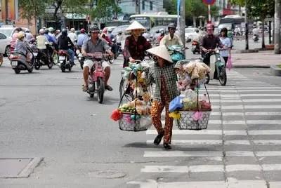 crossing a street in Ho Chi Minh Vietnam