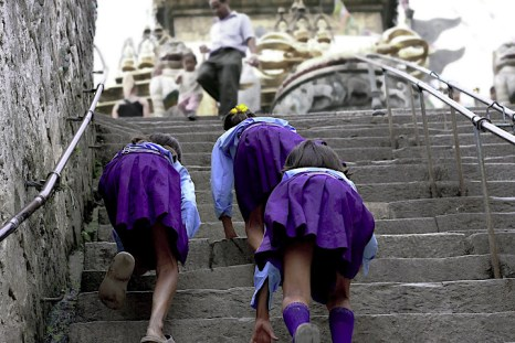 school girls run up to temple