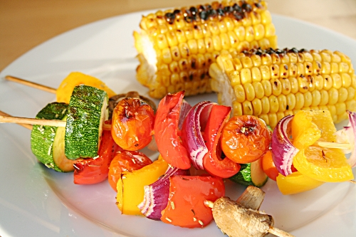 Vegetable kebabs and corn on the cob