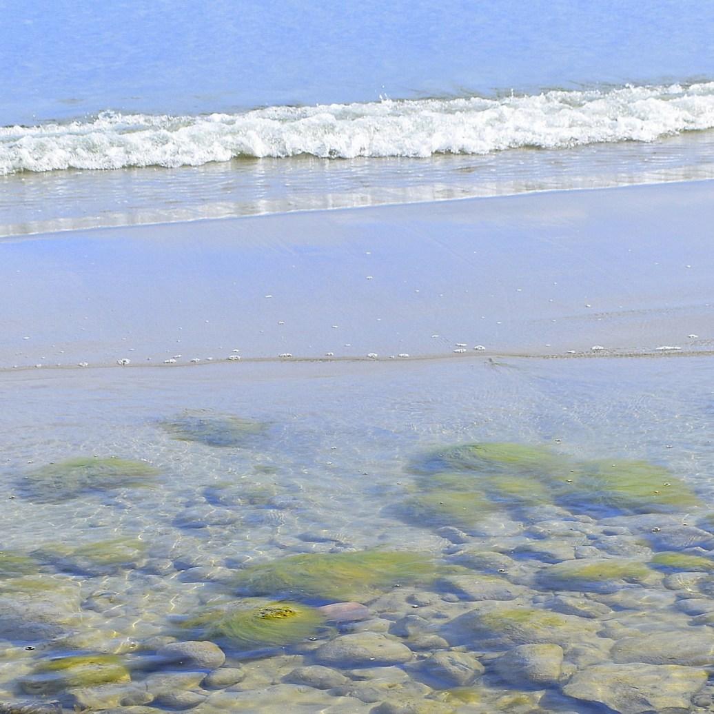 Steine und Wellen