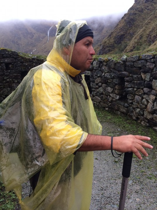 Augusto - assistant guide - explaining the history of some Inca ruins along the way