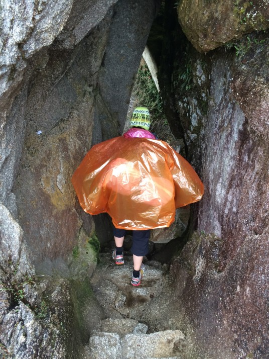 Poncho woman down a Inca tunnel