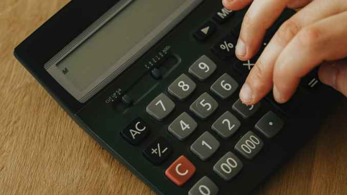 person using a black calculator