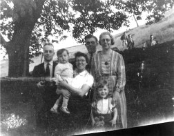 Summer 1944, the same day as the previous picture. I'm in front of my grandmother with my teddy, great aunt Clara holds my brother with her husband, great uncle Albert, at her side. My Dad at the back. At the rear of the back-to-back, one-up, one-down cottages (High Bank Cottages, no longer there), Moorhead, Shipley, where we lived until 1947.