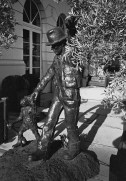 Street sculpture: man and monkey hand in hand