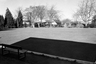 A busy place in the summer, the village bowling green is peacefully deserted on a bright but cold winter day