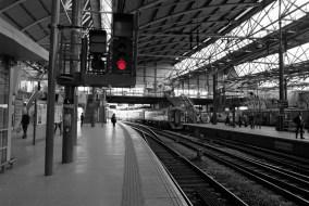 OM20. Inside Leeds station; colour neg desaturated except for the red lights