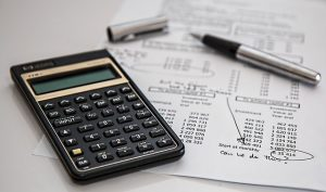 Calculator and piece of paper with calculation of moving insurance.