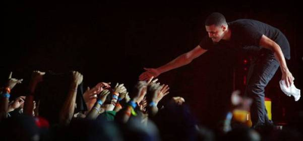 J Cole shakes hands with audience members during the Rock the Bells Festival in Devore on Sunday, September 8, 2013.