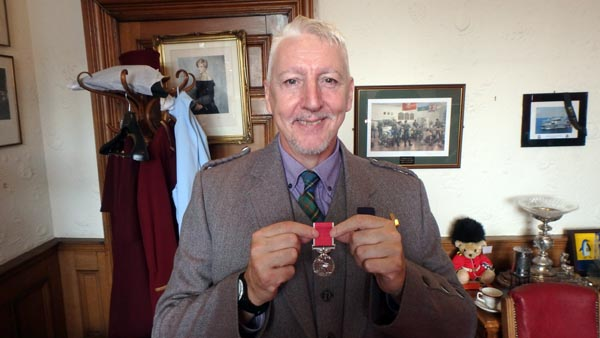 Kinny with his British Empire Medal: Photo by Nic Waller