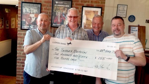 Pictured –  Derek, Ken and Chris from Eastbourne Rainbow and Andrew from the Hart with Sussex Beacon cheque.