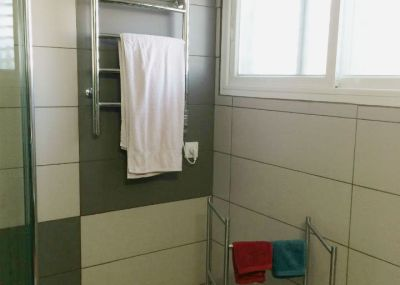 Towel heater in the modern bathroom