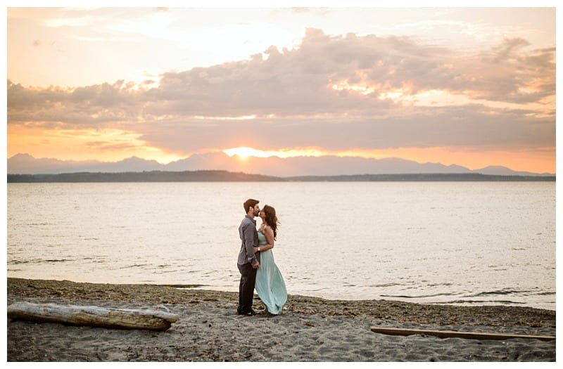 alki beach engagement session seattle beach at sunset couple orange sunset pinks and teal