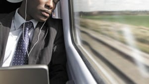 gty_man_sleeping_on_train_thg_111208_wmain