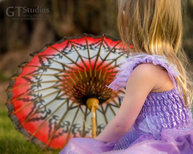 Girl with red parasol