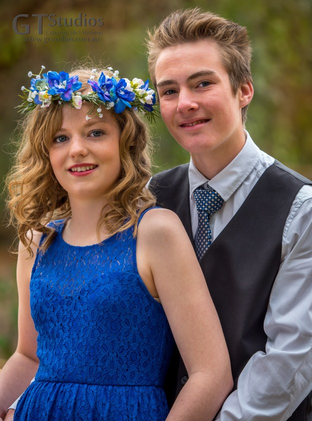 Mikayla and Marcus. Blue dress and blue floral crown.