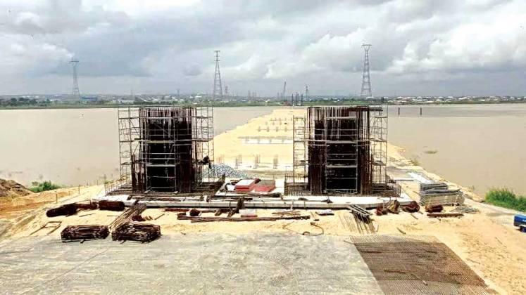 Image result for Work progressing at both ends of Second Niger Bridge -Works ministry
