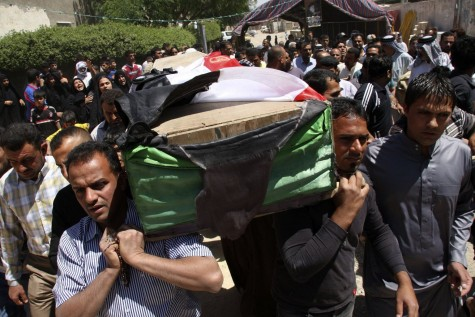 Iraqis carrying a coffin