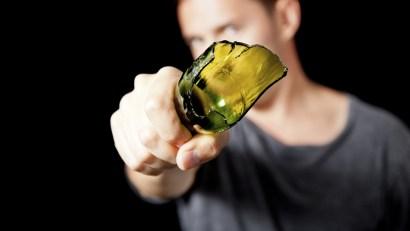 Man with broken beer bottle