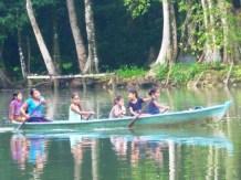 girls paddling to school