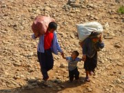 local family carrying heavy loads