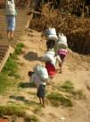 women carrying amazing loads uphill