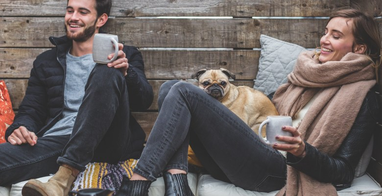 A young couple with a pug