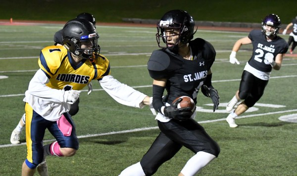 Photos: St. James-Lourdes football