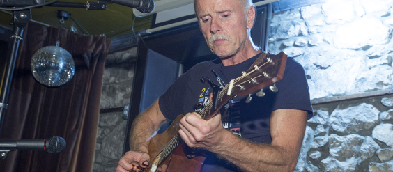 Grant Campbell plays guitar at the year-end gathering
