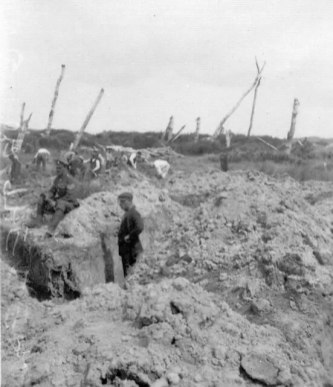 Aftermath: Clearing The Dead at Ypres : This unusual image from the early 1920s shows a British party from one of the Graves Registration units involved in clearing the dead from the Great War battlefields.