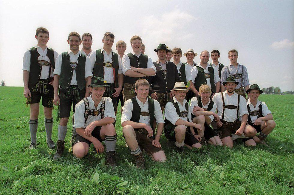 Bavarian men wearing short lederhosen.