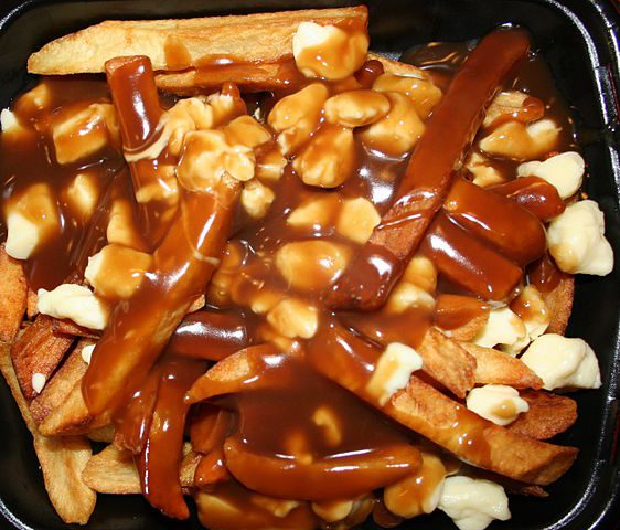 Poutine (French fried potatoes with cheese curds and beef gravy)
