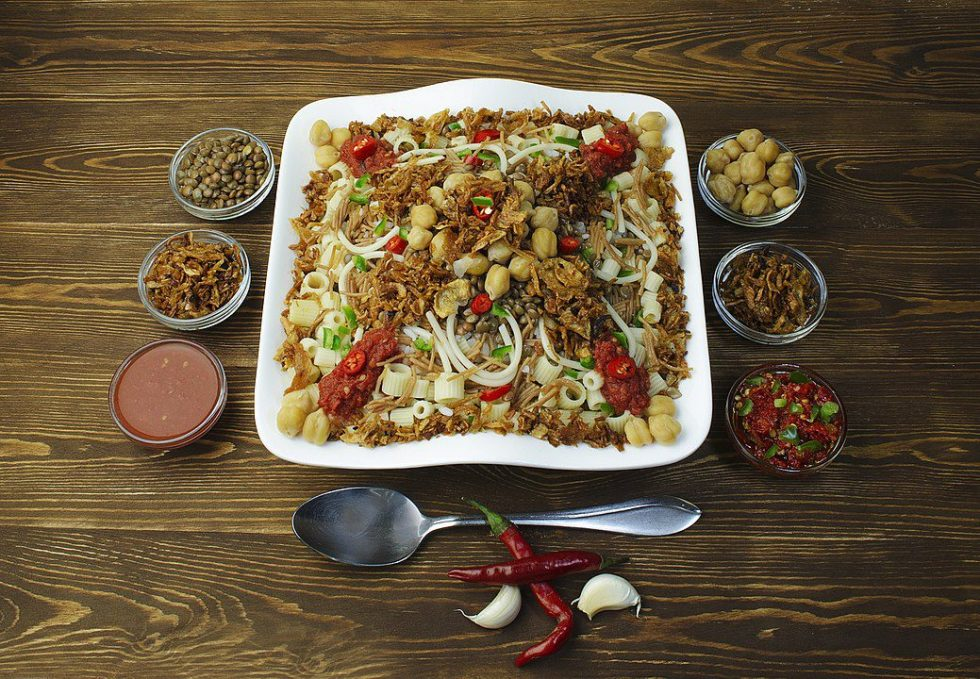 Kushari is Egypt's national dish and a popular street food. It's made from rice, macaroni, and lentils with a tomato sauce, garlic vinegar,  chickpeas, and fried onions.