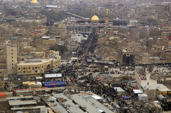 Shi'a and Sunni Muslims make their way to the Imam Husayn Shrine in Karbala, Iraq