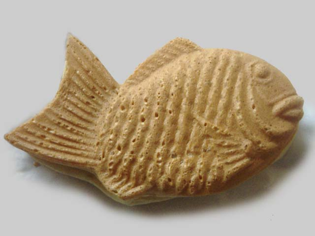 Taiyaki is a Japanese fish-shaped cake that is often filled with red bean paste.