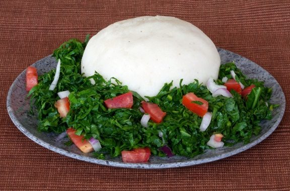 Ugali is a type of maize flour porridge and is a staple of Kenyan cuisine.