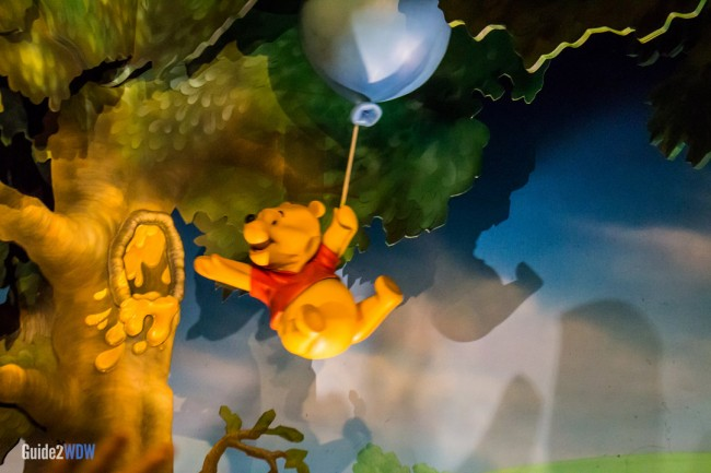 Pooh floating with a balloon - Many Adventures of Winnie the Pooh - Magic Kingdom Attraction
