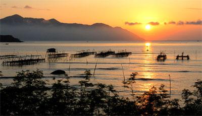 Coucher du soleil sur le marais de Na Phu