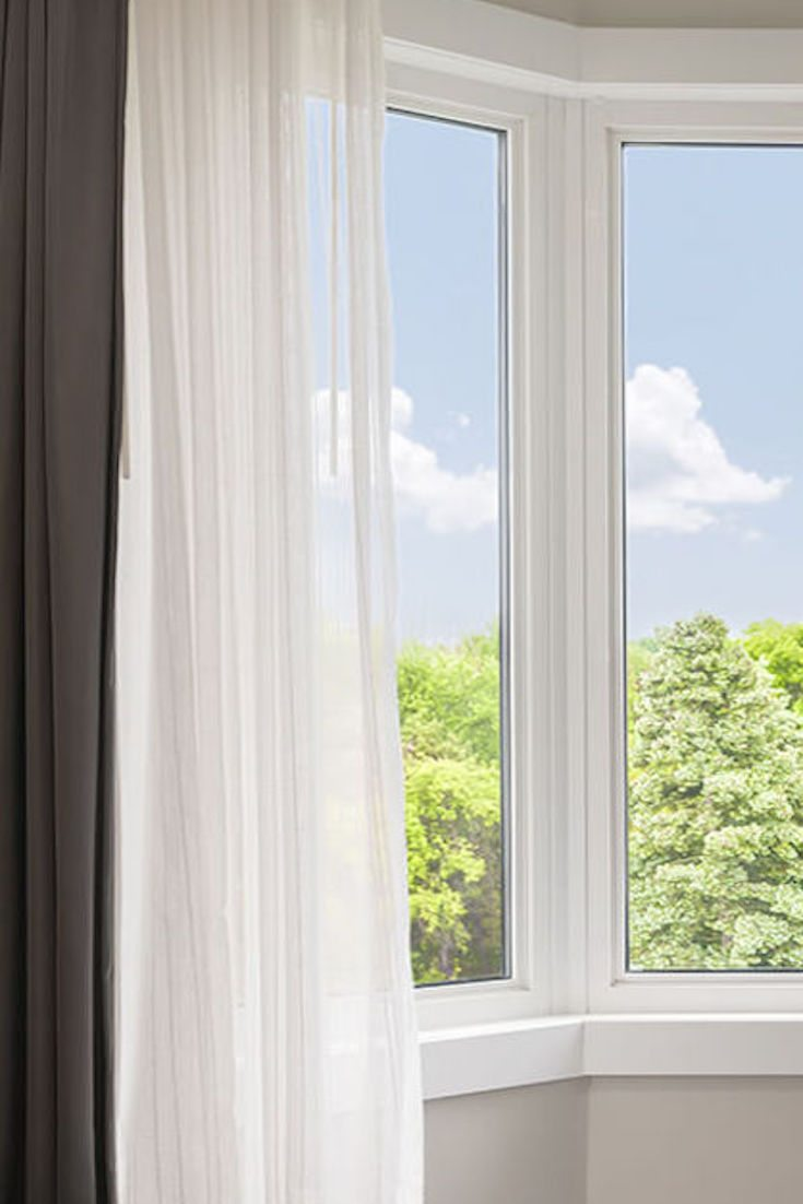 to hang bay window curtains