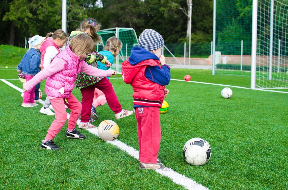 Kids playing soccer football maintaining healthy lifestyle