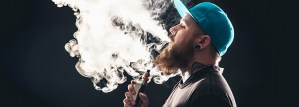 man blowing vapor
