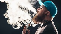 man blowing vapor