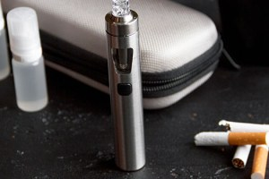 vaping device by tobacco cigarettes