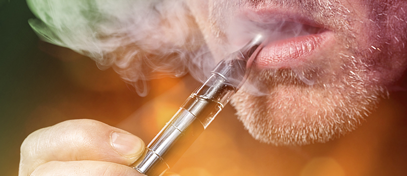 man vaping e-cigarette