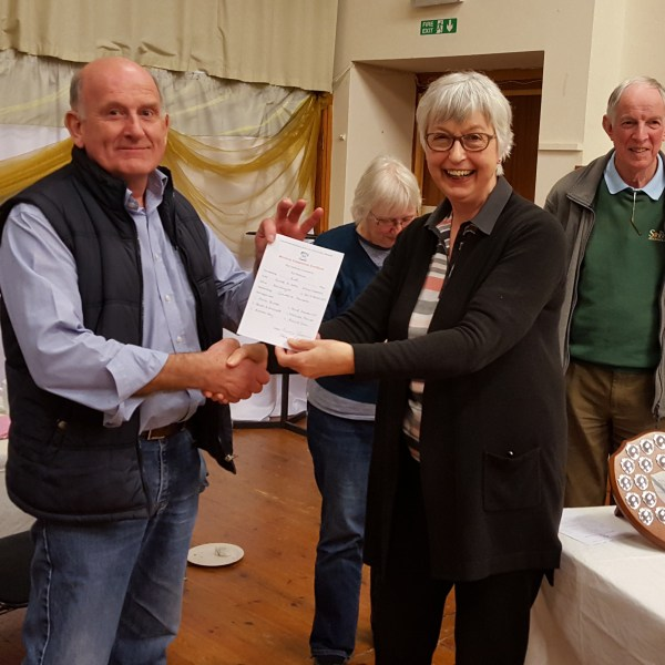 Andy Day receiving a certificate on behalf of Yorktown