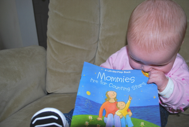 Here is a book Nana reads to me, and when done, I get to kiss/eat it.  For a milisecond, until NANA OF THE NORTH takes the thing away!  She says I have BOARD books for that... NO FUN NANA