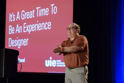 "A photo of Jared Spool in front of a presentation entitled ""It's a great time to be an experience designer""; Published as part of the post ""my 5 favorite UX conferences"""