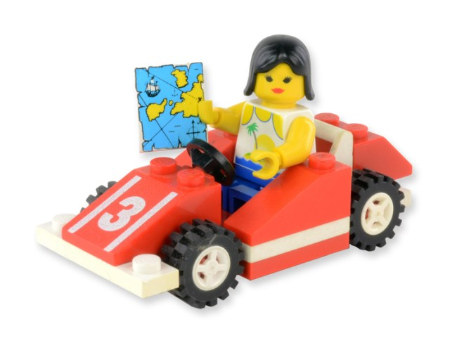 "A Lego woman in a race car holding a map, Published as part of User-Generated Content Strategy in ""The Free Repair Guide for Everything"""